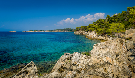 sithonia: Sithonia coast panoramic view with turquoise sea and a blue sky.