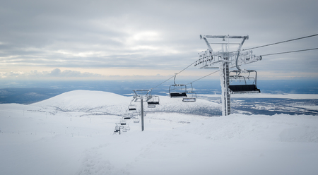 ski lift: Ski lift top station at alpine ski resort landscape. Hibini, Russia