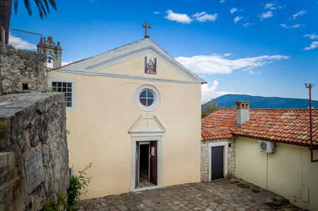 door bell: Small church with bell tower and opened door. Herceg Novi old fortress, Montenegro. Stock Photo