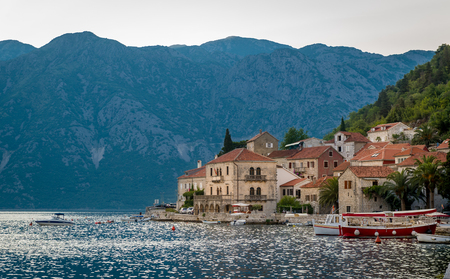 catchlight: Perast old village in the Bay of Kotor. Old town, Adriatic sea and Montenegrin mountains landscape. Montenegro. Stock Photo