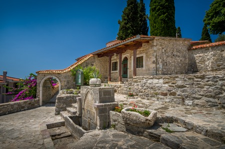 drinkable: Historical buildings in Old Town of Bar, stone house and drinkable water tap. Bar, Montenegro. Stock Photo