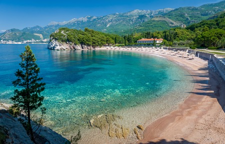budva: Beautiful Montenegro bay with sand beach and perfect Adriatic sea water Stock Photo