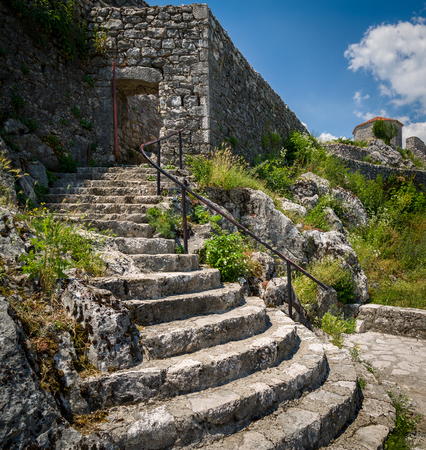 back gate: Bedem abandoned ancient fortress in Niksic town, Montenegro. Old stairs to the back gate.