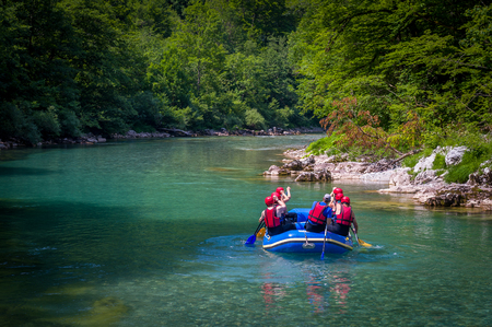 Rafting in the canyon of mountain river Tara. Beautiful mountain river canyon - popular touristic entertainment spot. Montenegro.