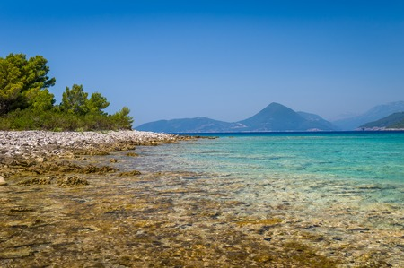 seascapes: Beautiful sea shore. transparent water of Mirista bay, mountain range on a background. Seascapes of Adriatic sea, Montenegro