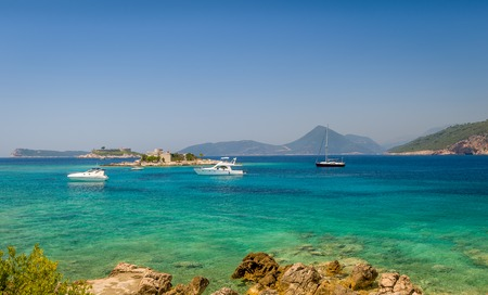 anchorage: Adriatic sea bay near Fort Arzla. Recreational sailing and motor boat anchorage. Summer resorts of Montenegro. Stock Photo