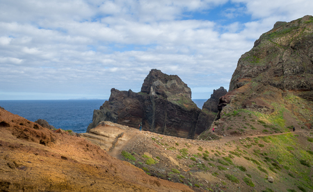 astern: Beautiful hiking path to the astern cape of Madeira islands. Tourists is walking to discover the beauty of Madeira. Portugal.