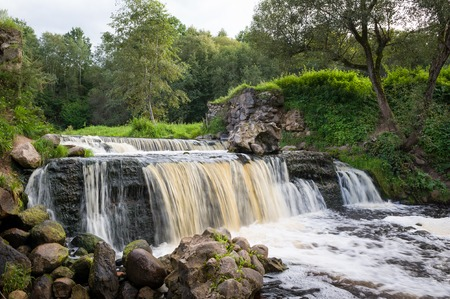 a bathing place: Waterfall in Belarus, popular place for recreation and bathing in the stream. Miori, river Viata.