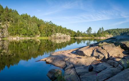 karelia: Green forest and stone shores. Beautiful nature of Karelia.