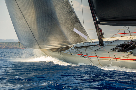 Racing sailing yacht going fast in the Mediterranean sea. Sardinia island race, Italy Standard-Bild
