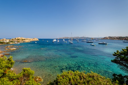 anchorage: Scenic bay with turquoise water and sailing boat anchorage. Porto Massimo, Sardinia, Italy.