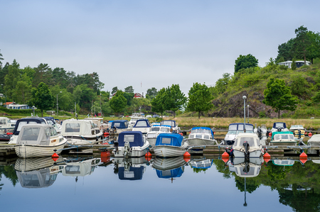 fishing fleet: Small fishing boats at Falkensten village camping. Norway. Stock Photo