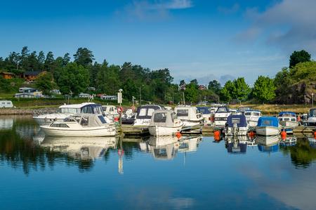 Falkensten town marina. Recreational fleet of motor boats. Norway.