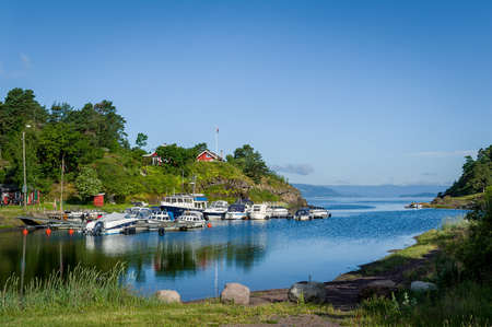 Typical nordic bay with recreational boats moored. Falkensten, Norway. Stock Photo