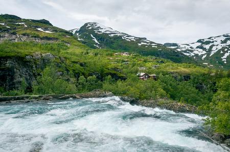 Mountain river and upper point of Kjosfossen waterfall. Norwegian landscape.