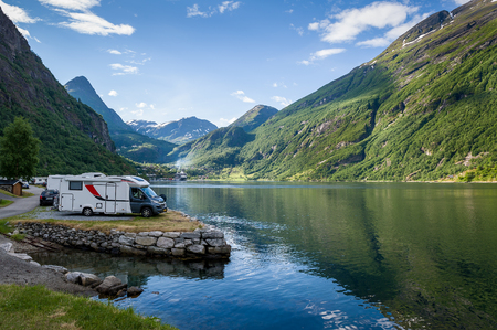 Camping site at Geiranger fjord shore. Evening light and calm summer day in Norway. Stock Photo - 68462633