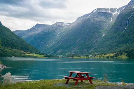 Camp table on the fjord shore, Norway. Stock Photo