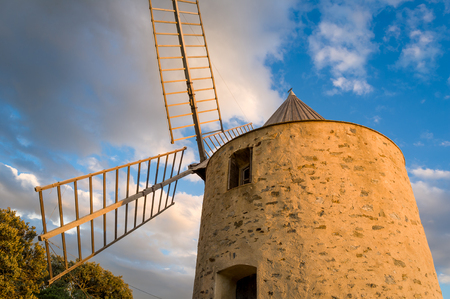 Porquerolles island landmark - old windmill at the hill above the town. Stock Photo