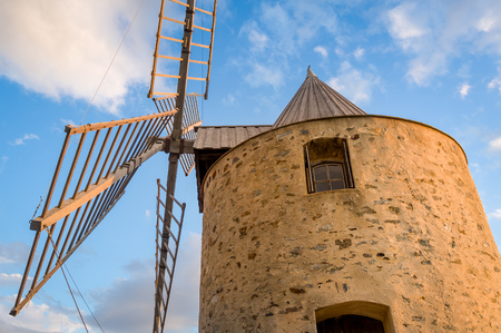 Sunset close up view of old windmill. Porquerolles island, France. Stock Photo