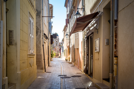 Narrow streets of Saint-Tropez old town. Provence Cote d'Azur, France. Stock Photo - 114302210
