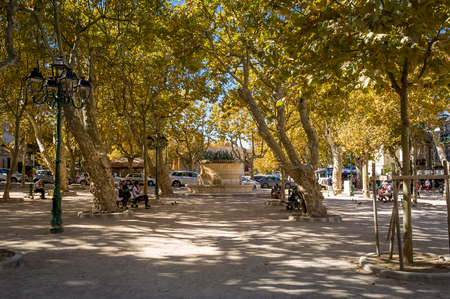 Small park at the central square of Saint-Tropez surrounded by restaurants. Provence Cote dAzur, France.