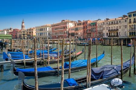 Beautiful gondolas boats moored at Venice channel. Veneto, Italy.