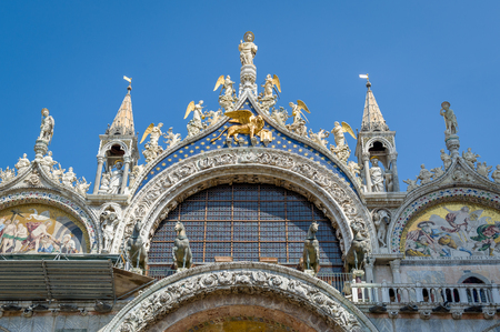 Beautiful decorated historic facade of basilica at the Piazza San Marco. Venice, Italy.