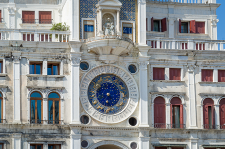 Old facade watch decoration of Piazza San Marco basilica. Venice, Italy.