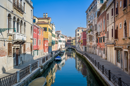 Sunny view of empty channel and street of Venice old town. Veneto, Italy. Stock Photo
