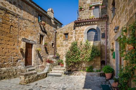 Civita di Bagnoregio medieval houses. Tuscany historic landmarks, Italy. Stock Photo - 114302134