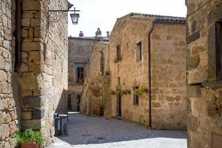 Old streets of Civita di Bagnoregio - town on the rocks, Toscany, Italy. Stock Photo - 114302136