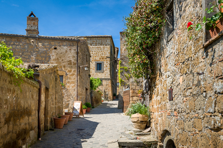 Old streets and medieval walls of Civita di Bagnoregio. Tuscany attractions, Italy. Stock Photo - 114302137