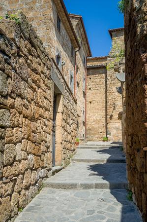 Vertica photo of Civita di Bagnoregio old town narrow street. Tuscany, Italy.