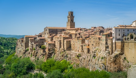Scenic view of Pitigliano old town in the fortress on the mountain. Tuscany, Italy.