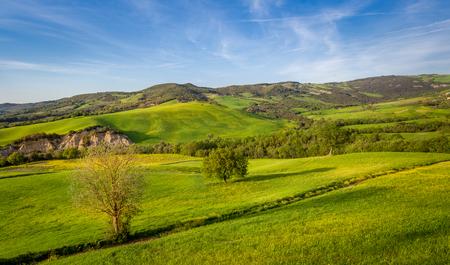 Toscana Val dOrcia fields landscape with evening sun beams. Tuscany region, Italy. Stock Photo