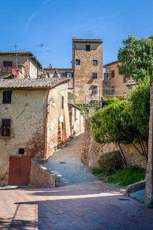 Vertical photo with old street of Certaldo town. Tuscany, Italy.