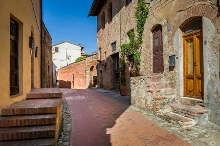 Narrow empty street with medieval houses of Certaldo. Toscana region, Italy. Stock Photo