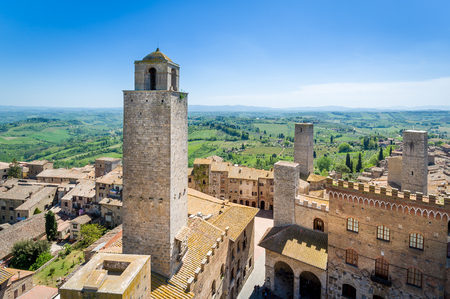 Aerial view of San Gimignano old town of towers and Toscana fields. Italy.
