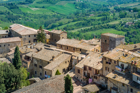 Aerial view of San Gimignano old houses. Travel touristic destinations of Tuscany, Italy.