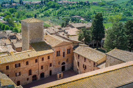 San Gimignano old town view from the fortress tower. Popular touristic and historical attraction of Tuscany, Italy. Stock Photo