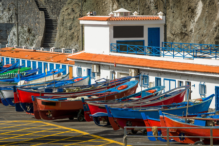 Colorful old style fishing boats close view. Pier of San Marcos bay. Tenerife island, Spain. Stock Photo