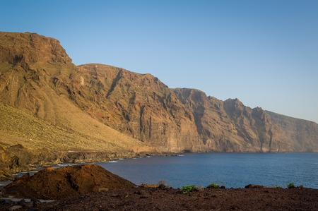 Sunset view from Punta de Tena to famous Los Gigantes rocks. Tenerife island, Canarias, Spain.