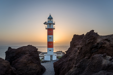 Punta de Teno Lighthouse and ocean view at sunset. Popular touristic destination at Tenerife island. Canary islands, Spain. Stock Photo