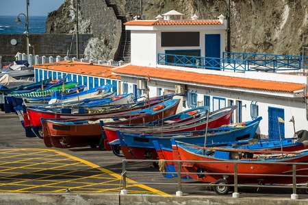 Colorful retro style wooden fishing boats at pier of San Marcos bay. Tenerife island, Spain.