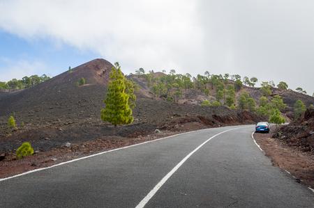Mountain road at Teide volcano national park. Tenerife island, Spain. Stock Photo