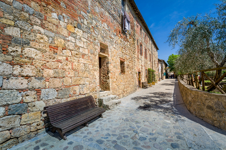 Monteriggioni old town empty street. Ancient fortress town of Tuscany, Italy.