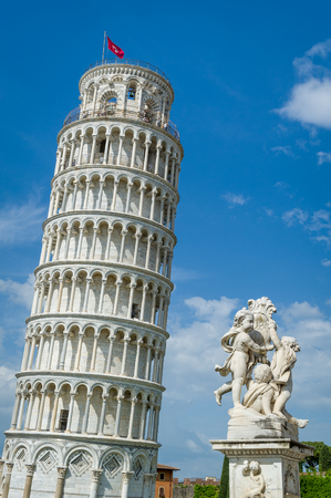 Vertical photo of famous Pisa Tower and Putti Fountain sculpture. Toscana travel attractions, Italy.