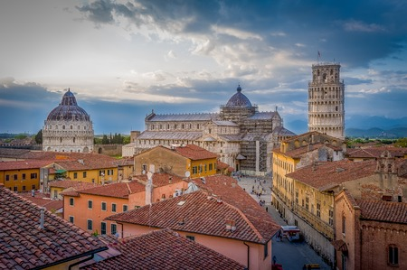 Sunset aerial view of Pisa historic center with famous leaning tower and Duomo di Pisa cathedral.