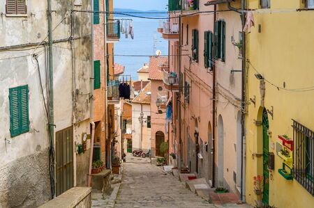 Typical old town narrow street. Porto Santo Stefano, Toscana, Italy 版權商用圖片