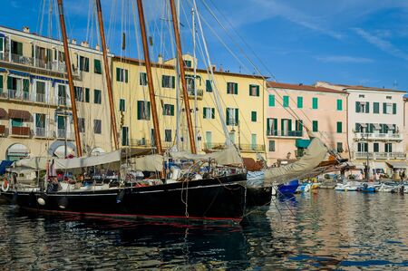 Old-fashion wooden sailing boats at Portoferraio marina, Elba island, Italy